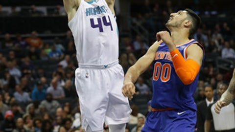 CHARLOTTE, NC - DECEMBER 18:  Frank Kaminsky #44 of the Charlotte Hornets drives to the basket against Enes Kanter #00 of the New York Knicks during their game at Spectrum Center on December 18, 2017 in Charlotte, North Carolina.  NOTE TO USER: User expressly acknowledges and agrees that, by downloading and or using this photograph, User is consenting to the terms and conditions of the Getty Images License Agreement.  (Photo by Streeter Lecka/Getty Images)