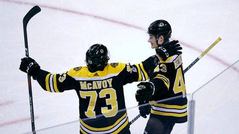 Boston Bruins center Danton Heinen, right, is congratulated by Charlie McAvoy after his goal during the third period of an NHL hockey game against the Columbus Blue Jackets in Boston, Monday, Dec. 18, 2017. (AP Photo/Charles Krupa)