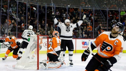 Los Angeles Kings' Drew Doughty (8) celebrates next to Philadelphia Flyers' Brian Elliott (37) after a goal by Adrian Kempe during the third period of an NHL hockey game, Monday, Dec. 18, 2017, in Philadelphia. Los Angeles won 4-1. (AP Photo/Matt Slocum)