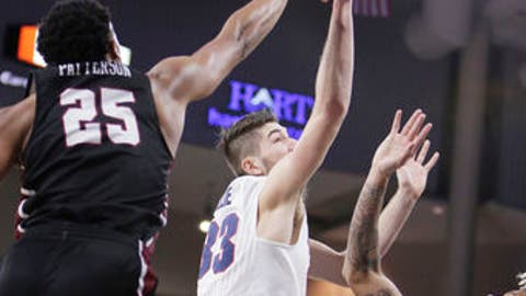 Gonzaga forward Killian Tillie (33) shoots between IUPUI guard Ron Patterson (25) and guard T.J. Henderson (1) during the first half of an NCAA college basketball game in Spokane, Wash., Monday, Dec. 18, 2017. (AP Photo/Young Kwak)