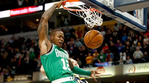 INDIANAPOLIS, IN - DECEMBER 18:  Terry Rozier #12 of the Boston Celtics dunks the winning basket during the 112-111 victory over the Indiana Pacers at Bankers Life Fieldhouse on December 18, 2017 in Indianapolis, Indiana.  NOTE TO USER: User expressly acknowledges and agrees that, by downloading and or using this photograph, User is consenting to the terms and conditions of the Getty Images License Agreement.  (Photo by Andy Lyons/Getty Images)