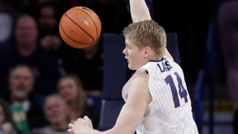 Gonzaga center Jacob Larsen (14) dunks during the first half of an NCAA college basketball game against IUPUI in Spokane, Wash., Monday, Dec. 18, 2017. (AP Photo/Young Kwak)