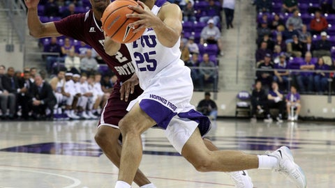 TCU guard Alex Robinson (25) drives past Texas Southern guard Derrick Bruce (2) during an NCAA college basketball game, Monday, Dec. 18, 2017. (AP Photo/Richard W. Rodriguez)