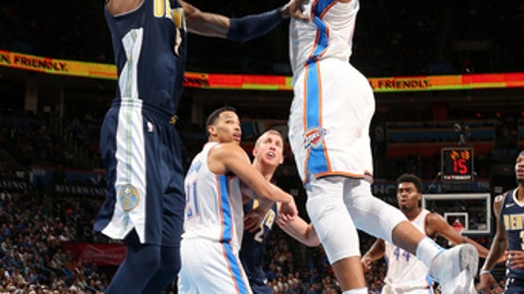 OKLAHOMA CITY, OK - DECEMBER 18: Russell Westbrook #0 of the Oklahoma City Thunder shoots the ball during the game against the Denver Nuggets on December 18, 2017 at Chesapeake Energy Arena in Oklahoma City, Oklahoma. NOTE TO USER: User expressly acknowledges and agrees that, by downloading and or using this photograph, User is consenting to the terms and conditions of the Getty Images License Agreement. Mandatory Copyright Notice: Copyright 2017 NBAE (Photo by Layne Murdoch/NBAE via Getty Images)