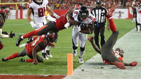 Atlanta Falcons wide receiver Julio Jones is stopped just short of the end zone by three Tampa Bay Buccaneers defenders with linebacker Adarius Glanton making the tackle during the second quarter of an NFL football game in Tampa, Fla., Monday, Dec. 18, 2017. (Curtis Compton/Atlanta Journal-Constitution via AP)