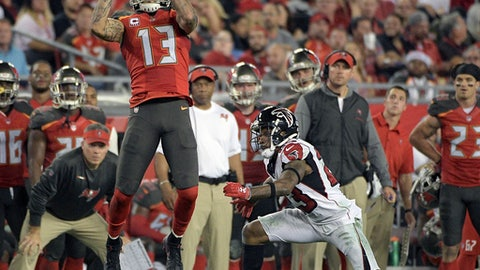 Tampa Bay Buccaneers wide receiver Mike Evans (13) make a reception in front of Atlanta Falcons cornerback Robert Alford during the first half of an NFL football game, Monday, Dec. 18, 2017, in Tampa, Fla. (AP Photo/Phelan M. Ebenhack)