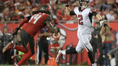 Atlanta Falcons quarterback Matt Ryan (2) looks for a receiver as he is pressured by Tampa Bay Buccaneers defensive end Will Clarke during the second half of an NFL football game, Monday, Dec. 18, 2017, in Tampa, Fla. (AP Photo/Phelan M. Ebenhack)
