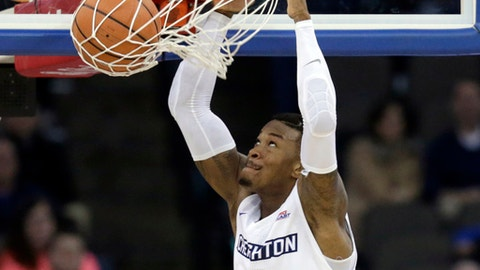 Creighton's Marcus Foster (0) dunks the ball during the second half of an NCAA college basketball game against Texas-Arlington in Omaha, Neb., Monday, Dec. 18, 2017. Creighton won 90-81. (AP Photo/Nati Harnik)