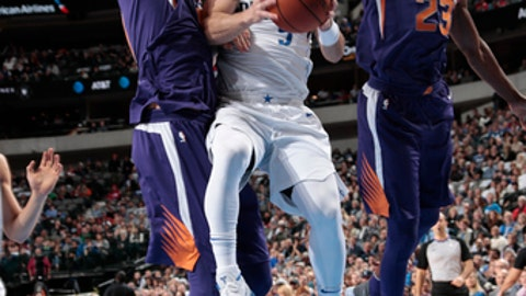 DALLAS, TX - DECEMBER 18: J.J. Barea #5 of the Dallas Mavericks drives to the basket against the Phoenix Suns on December 18, 2017 at the American Airlines Center in Dallas, Texas. NOTE TO USER: User expressly acknowledges and agrees that, by downloading and or using this photograph, User is consenting to the terms and conditions of the Getty Images License Agreement. Mandatory Copyright Notice: Copyright 2017 NBAE (Photo by Glenn James/NBAE via Getty Images)