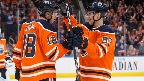 Edmonton Oilers' Ryan Strome (18) and Matthew Benning (83) celebrate a goal against the San Jose Sharks during the third period of an NHL hockey game in Edmonton, Alberta, Monday, Dec. 18, 2017. The Oilers won, 5-3. (Jason Franson/The Canadian Press via AP)