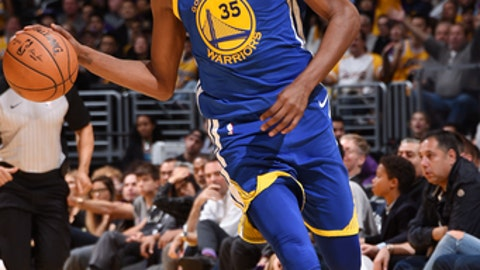 LOS ANGELES, CA - DECEMBER 18: Kevin Durant #35 of the Golden State Warriors handles the ball against the Los Angeles Lakers on December 18, 2017 at STAPLES Center in Los Angeles, California. NOTE TO USER: User expressly acknowledges and agrees that, by downloading and/or using this Photograph, user is consenting to the terms and conditions of the Getty Images License Agreement. Mandatory Copyright Notice: Copyright 2017 NBAE (Photo by Andrew D. Bernstein/NBAE via Getty Images)