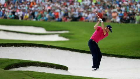 FILE - In this Aug. 13, 2017, file photo, Justin Thomas hits from the bunker on the 18th hole during the final round of the PGA Championship golf tournament at the Quail Hollow Club, in Charlotte, N.C. Thomas won his first major with key shots at the start and finish of the tournament. (AP Photo/Chuck Burton, File)