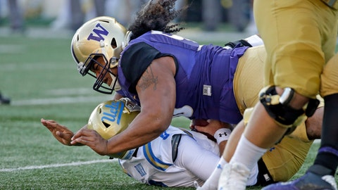 FILE - In this Oct. 28, 2017, file photo, Washington's Vita Vea sacks UCLA quarterback Josh Rosen in the first half of an NCAA college football game, in Seattle. Vea's impact on the game was enough that coaches voted the Washington defensive tackle the Pac-12 defensive player of the year. He's got likely one more game for the Huskies in the Fiesta Bowl against Penn State. (AP Photo/Elaine Thompson, File)