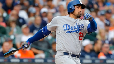 FILE - In this Aug. 18, 2017, file photo, Los Angeles Dodgers' Adrian Gonzalez hits a double against the Detroit Tigers in the second inning of a baseball game in Detroit. Adrian Gonzalez has been released by the Atlanta Braves and is a free agent. Atlanta acquired the 35-year-old as part of Saturday's five-player trade that sent outfielder Matt Kemp to the Los Angeles Dodgers and immediately designated him for assignment and placed him on waivers. Gonzalez waived his no-trade clause after the Braves agreed to cut him from their roster, and he was formally released Monday, Dec. 18, 2017. (AP Photo/Paul Sancya, File)