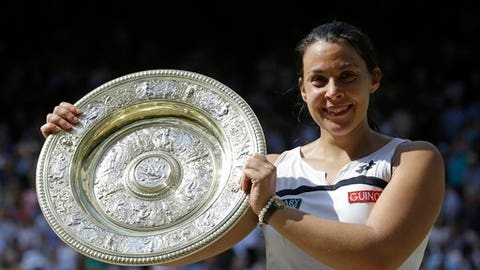 Former Wimbledon champion Bartoli comes back after four-year absence