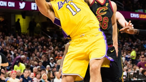 CLEVELAND, OH - DECEMBER 14: Brook Lopez #11 of the Los Angeles Lakers fights for a rebound with Kyle Korver #26 of the Cleveland Cavaliers during the first half at Quicken Loans Arena on December 14, 2017 in Cleveland, Ohio. NOTE TO USER: User expressly acknowledges and agrees that, by downloading and or using this photograph, User is consenting to the terms and conditions of the Getty Images License Agreement. (Photo by Jason Miller/Getty Images)