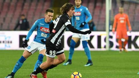 Udinese's Andrija Balic, right, and Napoli's Piotr Zielinski fight for the ball during an Italian Cup soccer match between Napoli and Udinese, at the San Paolo stadium in Naples, Tuesday, Jan. 19, 2017. (Ciro Fusco/ANSA via AP)