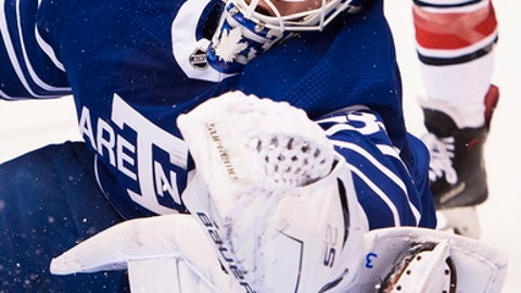 Toronto Maple Leafs goalie Frederik Andersen (31) makes a save against the Carolina Hurricanes during the first period of an NHL hockey game in Toronto on Tuesday, Dec. 19, 2017. (Nathan Denette/The Canadian Press via AP)