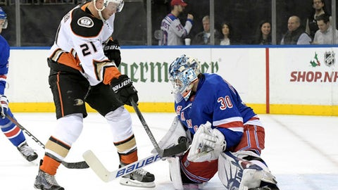 New York Rangers goalie Henrik Lundqvist (30) makes a save on a shot by Anaheim Ducks center Chris Wagner (21) during the first period of an NHL hockey game, Tuesday, Dec.19, 2017, at Madison Square Garden in New York. (AP Photo/Bill Kostroun)