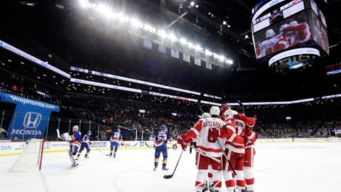 The Detroit Red Wings celebrate a goal by Gustav Nyquist during the first period of an NHL hockey game against the New York Islanders, Tuesday, Dec. 19, 2017, in New York. (AP Photo/Frank Franklin II)