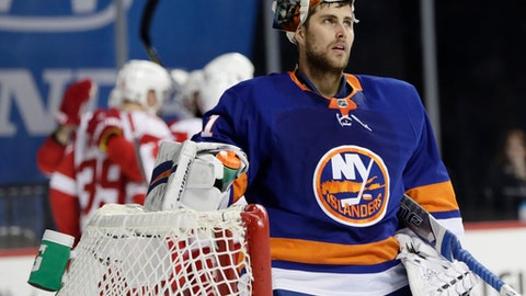 New York Islanders goalie Thomas Greiss reacts after Detroit Red Wings' Martin Frk scored a goal during the first period of an NHL hockey game, Tuesday, Dec. 19, 2017, in New York. (AP Photo/Frank Franklin II)