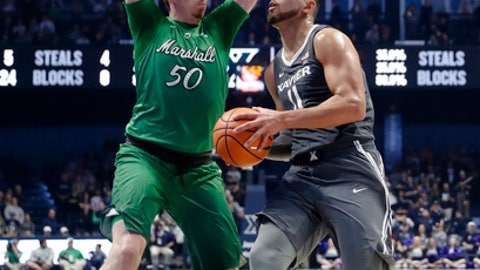 Xavier's Kerem Kanter (11) eyes the basket against Marshall's Milan Mijovic (50) in the second half of an NCAA college basketball game, Tuesday, Dec. 19, 2017, in Cincinnati. Xavier won 81-77. (AP Photo/John Minchillo)