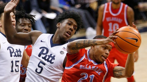 Pittsburgh's Marcus Carr (5) battles with Saleik Edwards for a renound in the second half of an NCAA college basketball game, Tuesday, Dec. 19, 2017, in Pittsburgh. (AP Photo/Keith Srakocic)