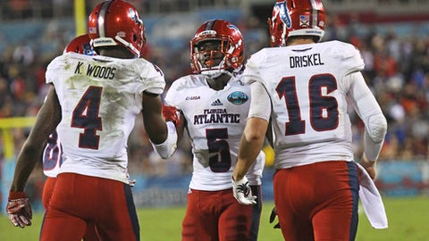 Florida Atlantic running back Devin Singletary (5) celebrates his touchdown with quarterback Jason Driskel (16) and wide receiver Kalib Woods (4) in the first half of an NCAA college football game against Akron in the Boca Raton Bowl in Boca Raton, Fla., Tuesday, Dec. 19, 2017. (Jim Rassol/South Florida Sun-Sentinel via AP)