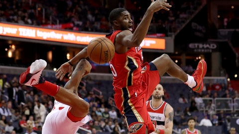 WASHINGTON, DC - DECEMBER 19: E'Twaun Moore #55 of the New Orleans Pelicans and Bradley Beal #3 of the Washington Wizards go for a loose ball in the first half at Capital One Arena on December 19, 2017 in Washington, DC. NOTE TO USER: User expressly acknowledges and agrees that, by downloading and or using this photograph, User is consenting to the terms and conditions of the Getty Images License Agreement. (Photo by Rob Carr/Getty Images)