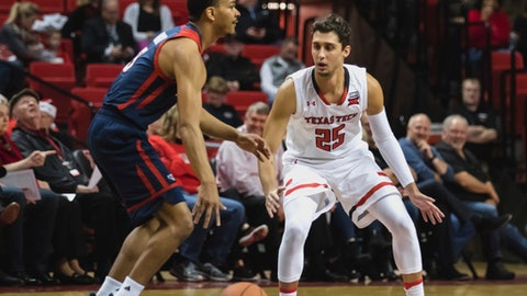 Texas Tech guard Davide Moretti (25) plays defense during the first half of an NCAA college basketball game against Florida Atlantic on Tuesday, Dec. 19, 2017, in Lubbock, Texas. (Jay Crain/Lubbock Avalanche-Journal via AP)
