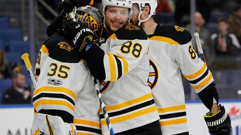 Boston Bruins forward David Pastrnak (88) celebrates a victory following the third period of an NHL hockey game against the Buffalo Sabres, Tuesday, Dec. 19, 2017, in Buffalo, N.Y. (AP Photo/Jeffrey T. Barnes)