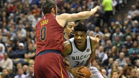 MILWAUKEE, WI - DECEMBER 19:  Giannis Antetokounmpo #34 of the Milwaukee Bucks works against Kevin Love #0 of the Cleveland Cavaliers during the first half of a game at the Bradley Center on December 19, 2017 in Milwaukee, Wisconsin.  NOTE TO USER: User expressly acknowledges and agrees that, by downloading and or using this photograph, User is consenting to the terms and conditions of the Getty Images License Agreement.  (Photo by Stacy Revere/Getty Images)
