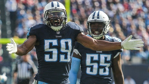FILE - In this Nov. 5, 2017, file photo, Tennessee Titans inside linebackers Wesley Woodyard (59) and Jayon Brown (55) celebrate a defensive stop during the Titans' 23-20 win over Baltimore, in Nashville. Tennessee linebacker Wesley Woodyard went vegetarian after finally getting a taste of the delicious burgers his teammates ate in the locker room. He has plenty of company on defense with 11 Titans jumping on the plant-based diet with lunches delivered by the Cordon Bleu-trained wife of linebacker Derrick Morgan. (Austin Anthony/Daily News via AP, File)
