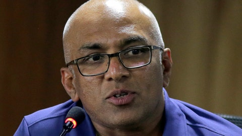 Sri Lanka's newly appointed cricket head coach Chandika Hathurusingha speaks during a media briefing in Colombo, Sri Lanka, Wednesday, Dec. 20, 2017. (AP Photo/Eranga Jayawardena)