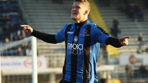 Atalanta's Andreas Cornelius celebrates after scoring his side's first goal during an Italian Cup soccer match between Atalanta and Sassuolo at the Atleti Azzurri D'Italia in Bergamo, Italy, Wednesday, Dec. 20, 2017. (Paolo Magni/ANSA via AP)