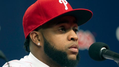 Philadelphia Phillies newly signed first baseman Carlos Santana speaks to the media during an introductory baseball press conference in Philadelphia, Wednesday, Dec. 20, 2017.  (Jose F. Moreno/The Philadelphia Inquirer via AP)