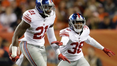 FILE - In this Oct. 15, 2017, file photo, New York Giants strong safety Landon Collins (21)  reacts after intercepting a pass during the first half of an NFL football game against the Denver Broncos in Denver. Collins was selected to the Pro Bowl on Tuesday, Dec. 19, 2017. (AP Photo/Joe Mahoney, File)