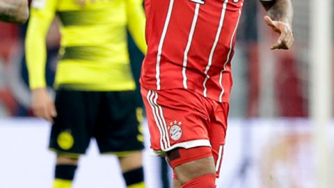 Bayern's Jerome Boateng celebrates after scoring the opening goal during the round of sixteen German soccer cup match between FC Bayern Munich and Borussia Dortmund in Munich, Germany, Wednesday, Dec. 20, 2017. (AP Photo/Matthias Schrader)