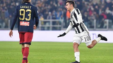 Juventus' Paulo Dybala, right, celebrates after scoring his team's first goal during an Italian Cup round of 16 soccer match between Juventus and Genoa, at Turin's Allians Stadium, Wednesday, Dec. 20, 2017. (Alessandro di Marco/ANSA via AP)
