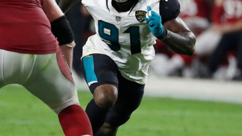 FILE - In this Sunday, Nov. 26, 2017 file photo, Jacksonville Jaguars defensive end Yannick Ngakoue (91) defends against the Arizona Cardinals during the first half of an NFL football game in Glendale, Ariz. Jaguars' Yannick Ngakoue on Pro Bowl voting: I was snubbed. Yannick Ngakoue plans to release his frustration on the football field. Ngakoue says he was overlooked by players, coaches and fans in voting for the Pro Bowl. Ngakoue was a third alternate in the AFC despite having 11 sacks and a league-leading six forced fumbles. (AP Photo/Rick Scuteri, File)