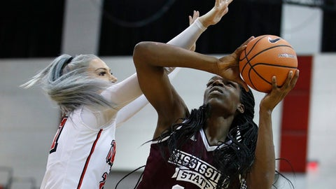 Mississippi State Teaira McCowan shoots over UNLV's Katie Powell during the first half of an NCAA college basketball game Wednesday, Dec. 20, 2017, in Las Vegas. (AP Photo/John Locher)