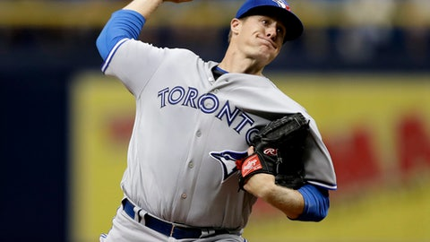 FILE - In this Thursday, Aug. 24, 2017 file photo, Toronto Blue Jays' Tom Koehler pitches to the Tampa Bay Rays during the first inning of a baseball game in St. Petersburg, Fla. Pitcher Tom Koehler and the Los Angeles Dodgers finalized a $2 million, one-year contract, a deal that raises next year's projected luxury tax payroll of the NL champions to $183 million. (AP Photo/Chris O'Meara, File)