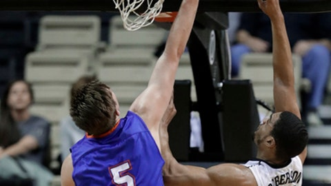 Houston Baptist forward David Caraher (5) scores against Vanderbilt forward Jeff Roberson in the first half of an NCAA college basketball game, Wednesday, Dec. 20, 2017, in Nashville, Tenn. (AP Photo/Mark Humphrey)