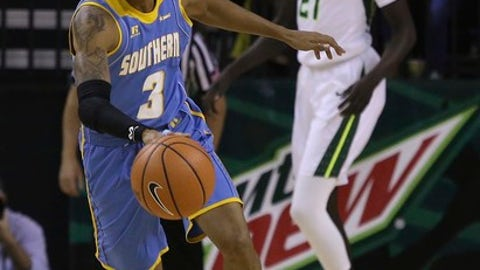 Southern University guard Eddie Reese (3) brings the ball up as Baylor forward Nuni Omot (21) watches during the first half of an NCAA college basketball game Wednesday, Dec. 20, 2017, in Waco, Texas. (AP Photo/Jerry Larson)