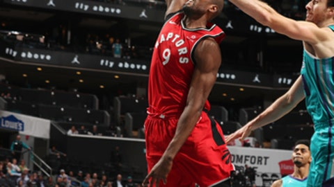 CHARLOTTE, NC - DECEMBER 20:  Serge Ibaka #9 of the Toronto Raptors drives to the basket against the Charlotte Hornets on December 20, 2017 at Spectrum Center in Charlotte, North Carolina. NOTE TO USER: User expressly acknowledges and agrees that, by downloading and or using this photograph, User is consenting to the terms and conditions of the Getty Images License Agreement.  Mandatory Copyright Notice:  Copyright 2017 NBAE (Photo by Kent Smith/NBAE via Getty Images)