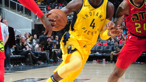 ATLANTA, GA - DECEMBER 20: Victor Oladipo #4 of the Indiana Pacers handles the ball against the Atlanta Hawks on December 20, 2017 at Philips Arena in Atlanta, Georgia. NOTE TO USER: User expressly acknowledges and agrees that, by downloading and/or using this photograph, user is consenting to the terms and conditions of the Getty Images License Agreement. Mandatory Copyright Notice: Copyright 2017 NBAE (Photo by Scott Cunningham/NBAE via Getty Images)