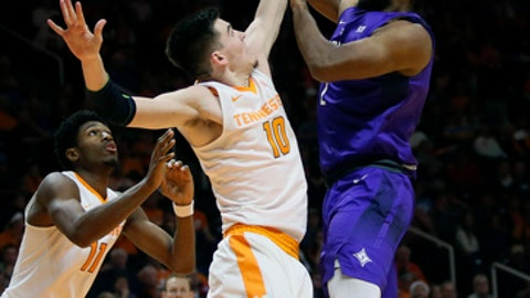 Furman forward Jalen Williams, right, is defended under the basket by Tennessee forward John Fulkerson (10) in the first half of an NCAA college basketball game, Wednesday, Dec. 20, 2017, in Knoxville, Tenn. (AP Photo/Crystal LoGiudice)