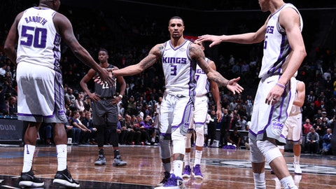BROOKLYN, NY - DECEMBER 20:  George Hill #3 of the Sacramento Kings high fives his teammates during the game against the Brooklyn Nets on December 20, 2017 at Barclays Center in Brooklyn, New York. NOTE TO USER: User expressly acknowledges and agrees that, by downloading and or using this Photograph, user is consenting to the terms and conditions of the Getty Images License Agreement. Mandatory Copyright Notice: Copyright 2017 NBAE (Photo by Nathaniel S. Butler/NBAE via Getty Images)