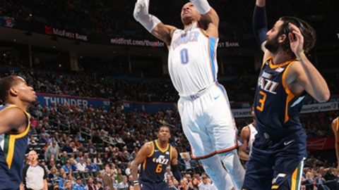 OKLAHOMA CITY, OK - DECEMBER 20:  Russell Westbrook #0 of the Oklahoma City Thunder dunks against the Utah Jazz on December 20, 2017 at Chesapeake Energy Arena in Oklahoma City, Oklahoma. NOTE TO USER: User expressly acknowledges and agrees that, by downloading and or using this photograph, User is consenting to the terms and conditions of the Getty Images License Agreement. Mandatory Copyright Notice: Copyright 2017 NBAE (Photo by Layne Murdoch/NBAE via Getty Images)