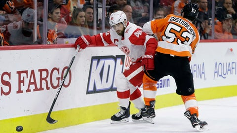 Detroit Red Wings' Henrik Zetterberg (40) tries to slip past Philadelphia Flyers' Shayne Gostisbehere (53) during the third period of an NHL hockey game, Wednesday, Dec. 20, 2017, in Philadelphia. Philadelphia won 4-3. (AP Photo/Matt Slocum)
